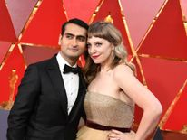 US-Pakistani stand-up comedian Kumail Nanjiani (L) and his wife Emily V. Gordon arrive for the 90th Annual Academy Awards on March 4, 2018, in Hollywood