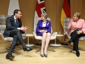 Theresa May, Emmanuel Macron and Angela Merkel