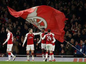 Arsenal's Danny Welbeck celebrates scoring their third goal with teammates