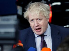 Britain's Foreign Secretary Boris Johnson talks to the media as he arrives at an European Union foreign ministers meeting in Brussels
