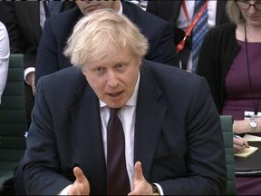 Boris Johnson is being quizzed by MPs