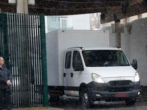 A truck leaves the British embassy compound in Moscow