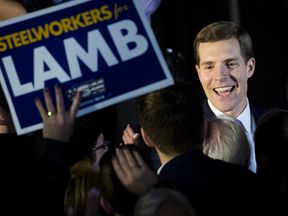 Conor Lamb, Democratic congressional candidate for Pennsylvania's 18th district, greets supporters at an election night rally March 14, 2018 in Canonsburg, Pennsylvania
