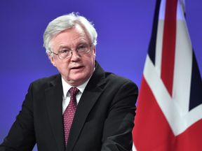 British Brexit minister David Davis addresses a press conference after his meeting with EU chief negotiator at the European Commission in Brussels