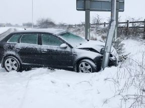 A car crashes off the A30 near Okehampton in Devon after heavy snow