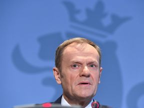 European Council President Donald Tusk speaks holds a press conference in Senningen