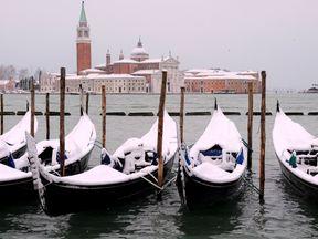 Snow covered gondolas near St. Mark's square in Venice lagoon