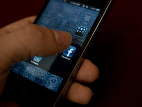 A view of and Apple iPhone displaying the Facebook app's splash screen May 10, 2012 in Washington, DC. Social-networking giant Facebook will go public on the NASDAQ May 18 with its initial public offering, trading under the symbol FB, in an effort to raise $10.6 billion. (Photo credit should read BRENDAN SMIALOWSKI/AFP/GettyImages)