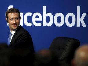 Facebook CEO Mark Zuckerberg is seen on stage during a town hall at Facebook's headquarters in Menlo Park, California September 27, 2015