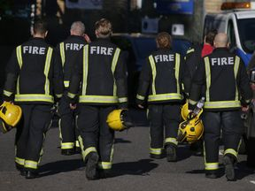 Firefighters walk away from the burning 24 storey residential Grenfell Tower block in Latimer Road, West London on June 14, 2017 in London, England. The Mayor of London, Sadiq Khan, has declared the fire a major incident as more than 200 firefighters are still tackling the blaze while at least six are dead and 20 are in critical care. (Photo by Jack Taylor/Getty Images)