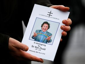The order of service for Ken Dodd's funeral is held outside Liverpool Cathedral, Liverpool, Britain, March 28, 2018