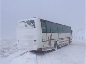 A stranded coach blocks the road beyond Littleborough near Rochdale