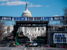 Construction workers setup the March For Our Lives stage ahead of the anti-gun rally in Washington, DC, on March 23, 2018