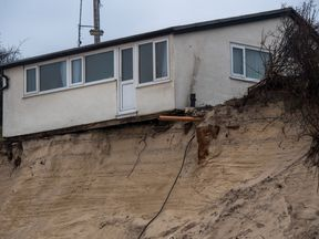 A house on Hemsby beach that has been evacuated after high winds and waves eroded the dunes on which it sits in Norfolk
