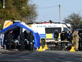 Police, Army and Emergency service personal on Larkhill Road in Durrington, Salisbury