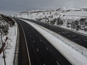 A closed section of the M62 motorway between junctions 22 and 23 in severe weather near Huddersfield