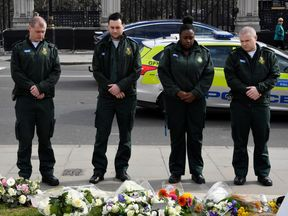 Emergency services workers pay their respects