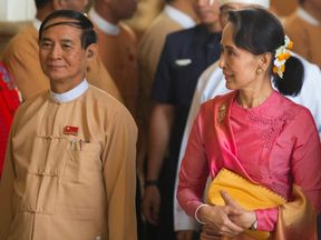Newly elected president Win Myint (L) is a close ally of Aung San Suu Kyi's