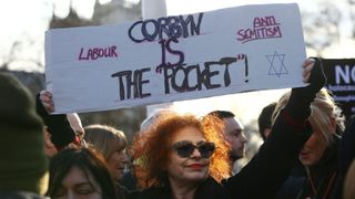 Protesters gather in Parliament Square, Westminster