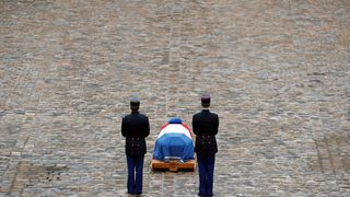 French Republican guards stand in front of the flag-draped coffin of late Gendarmerie officer Colonel Arnaud Beltrame, who was killed by an Islamist militant after taking the place of a hostage during a supermarket siege in Trebes, during a national ceremony at the Hotel des Invalides in Paris.