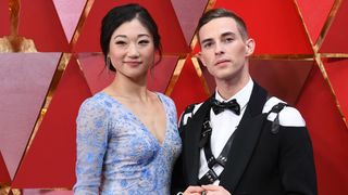 US figure skater Mirai Nagasu (L) and US Olympic medalist Adam Rippon arrive for the 90th Annual Academy Awards on March 4, 2018, in Hollywood, California