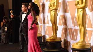 Actor Sam Rockwell and actress Viola Davis pose in the press room with the Oscar for Best Supportimg actor in ' Three Billboards outside Ebbing Missouri' during the 90th Annual Academy Awards on March 4, 2018, in Hollywood, California
