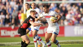 Scott Moore of Wakefield Wildcats holds off Adam OÕBrien of Bradford Bulls during the Million Pound Game between Wakefield Wildcats and Bradford Bulls at Belle Vue Stadium on October 3, 2015 in Wakefield, England. (Photo by Daniel Smith/Getty Images)