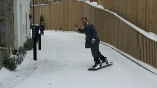 Undeterred by the snow that fell over Bristol, a businessman decided to go to work on snowboard on Friday, March 2.