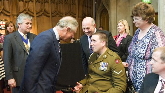 Ben Parkinson and his mother Diane Dernie (right) meeting Prince Charles at the Guildhall in the City of London.