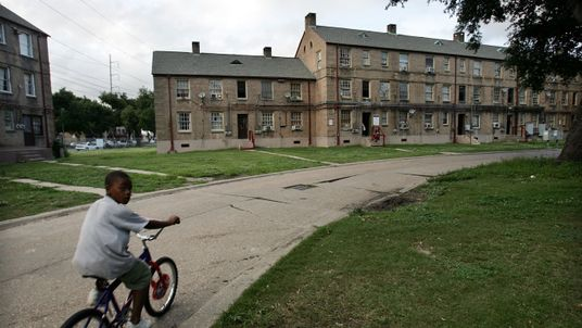 NEW ORLEANS - JUNE 07: A boy rides his bicycle in the B.W. Cooper housing project June 7, 2007 in New Orleans, Louisiana