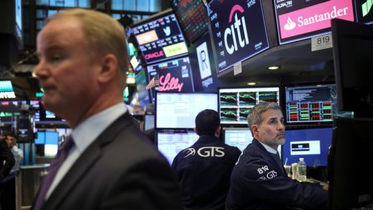 Traders and financial professionals work on the floor of the New York Stock Exchange (NYSE) ahead of the closing bell, March 22, 2018 in New York City. The Dow Jones industrial average closed down more than 700 points on Thursday afternoon. Markets reacted to the Trump administrationâs announcement of approximately $50 billion worth of yearly tariffs on Chinese imports