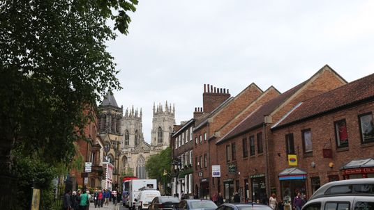Embargoed to 0001 Sunday March 18 File photo dated 30/05/14 of a street in York leading to York Minster. The city is the best place to live in Britain due to its combination of ancient beauty and a recent modernisation, according to a guide. PRESS ASSOCIATION Photo. Issue date: Sunday March 18, 2018. See PA story SOCIAL Places. Photo credit should read: Lynne Cameron/PA Wire