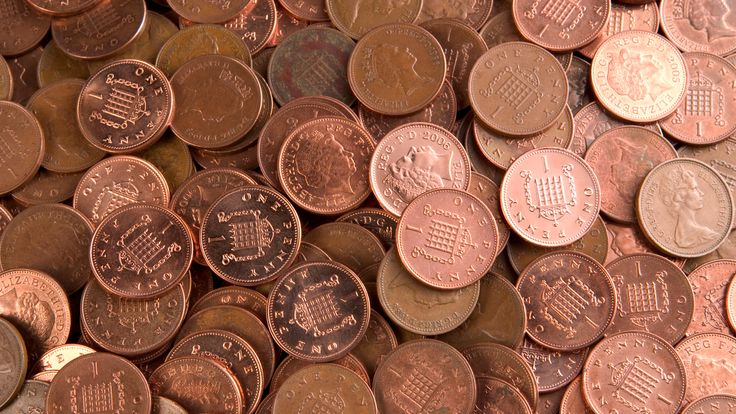 Lots of British one pence coins