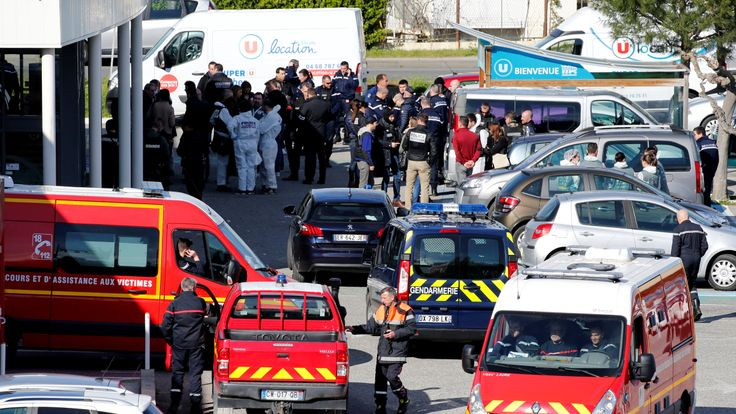 Rescue forces and police officers after the hostage situation in Trebes