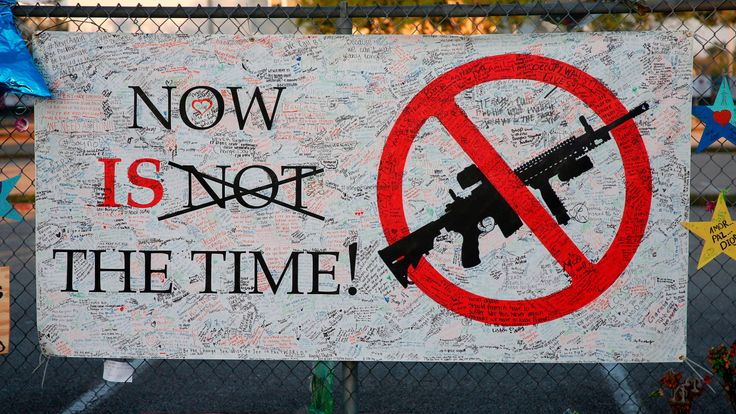 A sign hangs on a fence one at Marjory Stoneman Douglas High School in Parkland, Florida on February 27, 2018
