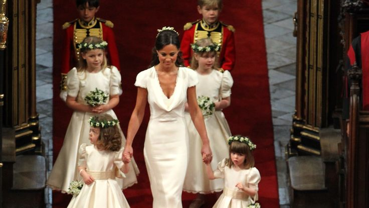 Maid of honour Pippa Middleton leads the flower girls and page boys down the aisle