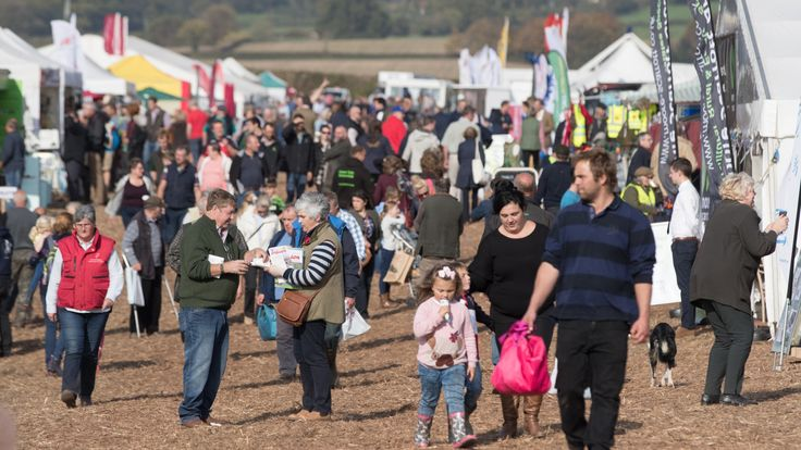 People browse the stalls at the 67th British National Ploughing Championships at Bishop's Lydeard near Taunton on October 15, 2017 in Somerset, England