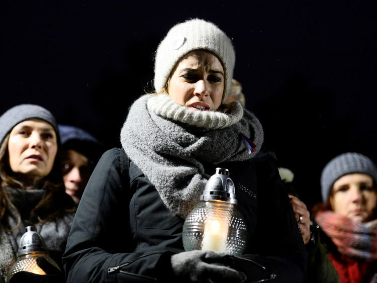 Slain Slovak journalist buried as police free suspects