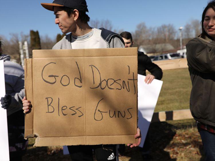 Anti-gun protesters outside the church
