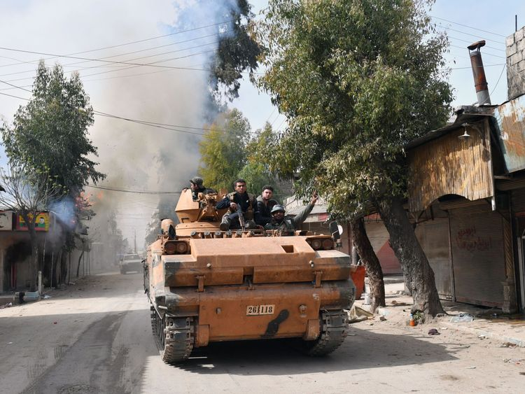 Turkish-backed Syrian rebels driving through Afrin