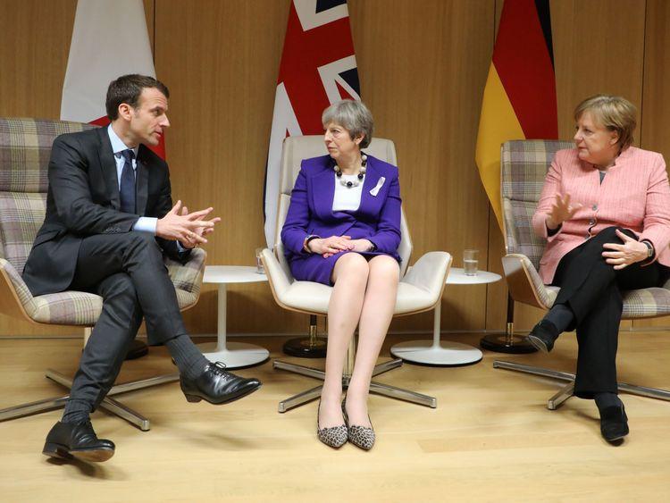 Theresa May, Emmanuel Macron and Angela Merkel