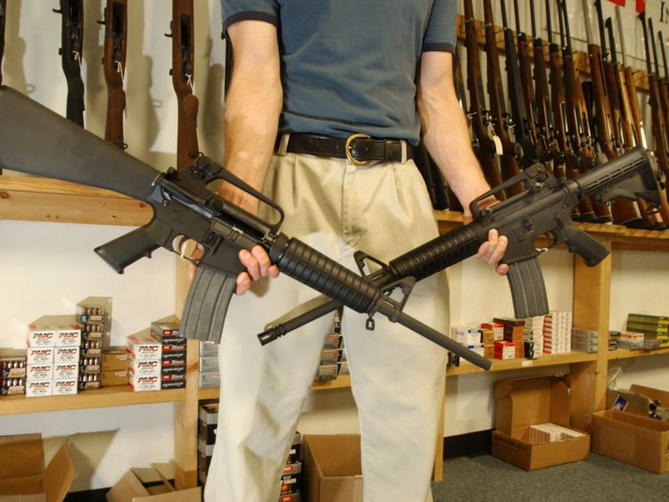 DENVER, CO - SEPTEMBER 13: The Manager of Dave's Guns holds two Colt AR-15's the gun on the right has a Bayonet Mount, Flash Supressor and a Collapsable Stock and can have a magazine high capacity load with more than 30 rounds and be purchased by civilians as of today, the gun on the left was legal to purchase and own with a 10 magazine round during the SAW Ban (Semi Automatic Wepons ban). Between 1994 and September 13, 2004 12:01am the AR-15 with the above items could only be sold to Law Enforcement and Military but today is know legal to civilians to purchase with the Brady Bill being expired. (Photo by Thomas Cooper/Getty Images)
