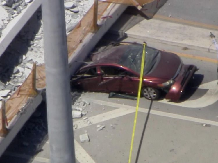 Several cars were seen trapped under the bridge
