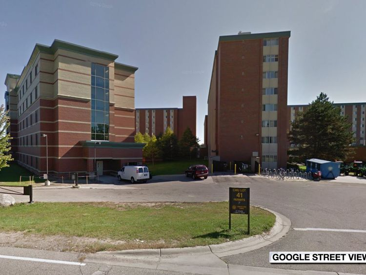 Police hunt gunman after two killed at US university