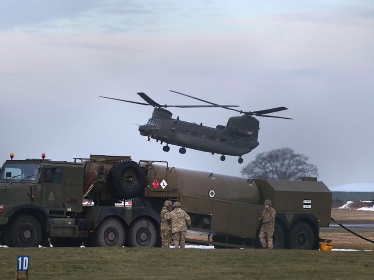 An RAF Chinook helicopter arrives at Carlisle airport before delivering supplies to communities still cut off after recent heavy snow in Cumbria
