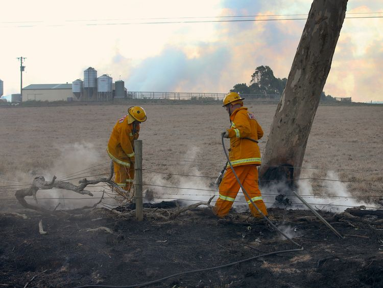 RTS1O4W018 Mar. 2018Melbourne, AustraliaFirefighters use water to put out spot fires near a farm on the outskirts of the town of Cobden, located south west of Melbourne, Australia March 18, 2018. AAP/David Crosling/via REUTERS ATTENTION EDITORS - THIS IMAGE WAS PROVIDED BY A THIRD PARTY. NO RESALES. NO ARCHIVE. AUSTRALIA OUT. NEW ZEALAND OUT.