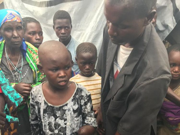 Mave, 11, ran away from two militiamen but they caught up and hacked at her head and neck