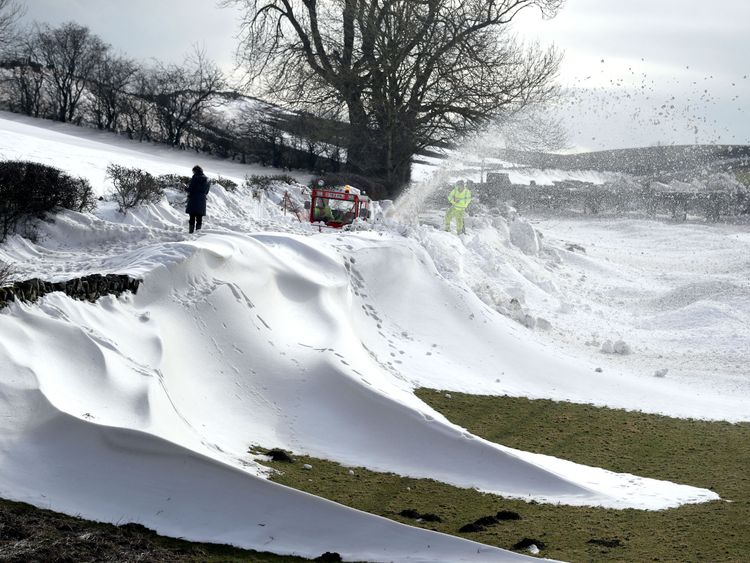 A snowblower clears the road to a small Hamlet which has been blocked since Thursday at Parkhead near Kirkoswald