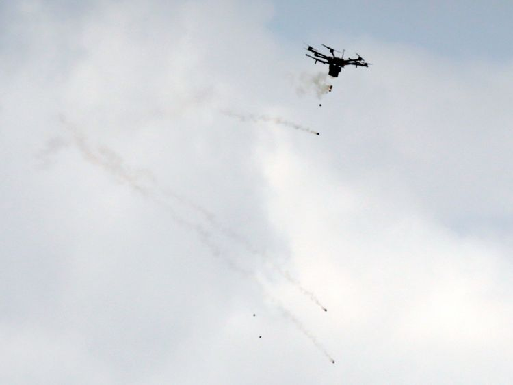 Israeli drone dropping tear gas grenades during clashes with Palestinian protesters at a tent city protest