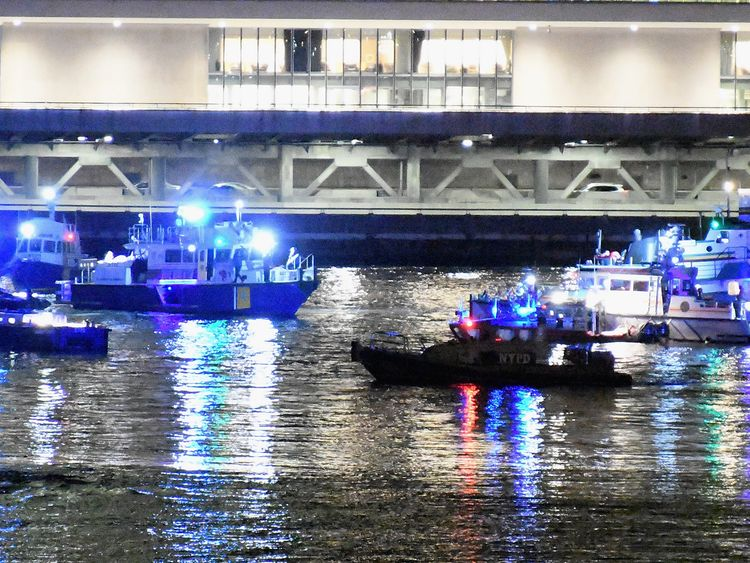 Emergency responders work at the scene of a helicopter crash in the East River March 11, 2018 in New York City. According to reports at least two people were killed